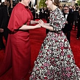 Olivia Colman and Kaitlyn Dever at the 2020 Golden Globes