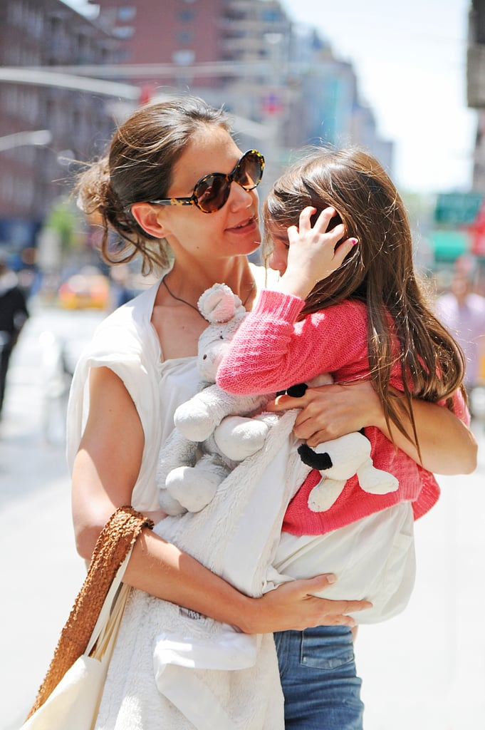 Katie Holmes carried Suri to Whole Foods in NYC yesterday afternoon. Suri brought a few stuffed animals along for the shopping trip while Katie had her reusable bags in hand. It's been a busy weekend for Katie, who spent much of her time meeting with lawyers. She wore a yellow dress and denim jacket for the important appointment which was apparently to discuss her divorce from Tom Cruise. Tom and Katie's lawyers are reportedly working on an agreement behind closed doors to avoid public drama. While the legal proceedings have been underway, Katie's been sticking around Manhattan with Suri and the duo have shared multiple outings including an ice cream date, a museum visit, and an afternoon at tea with friends.