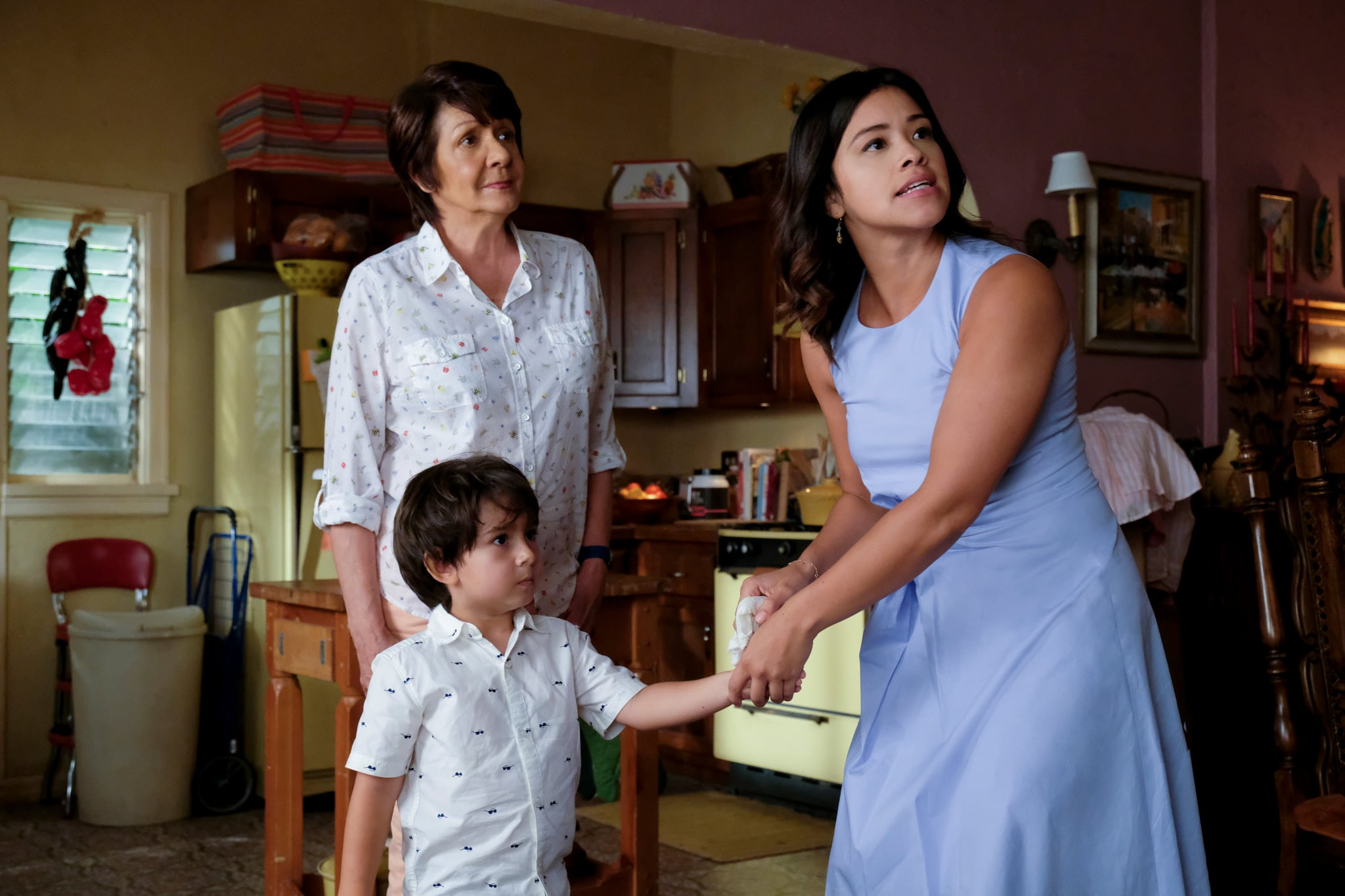 JANE THE VIRGIN, l-r: Ivonne Coll, Elias Janssen, Gina Rodriguez in 'Chapter Sixty-Six' (Season 4, Episode 2, aired October 20, 2017). ph: Scott Everett White/ The CW Network/courtesy Everett Collection