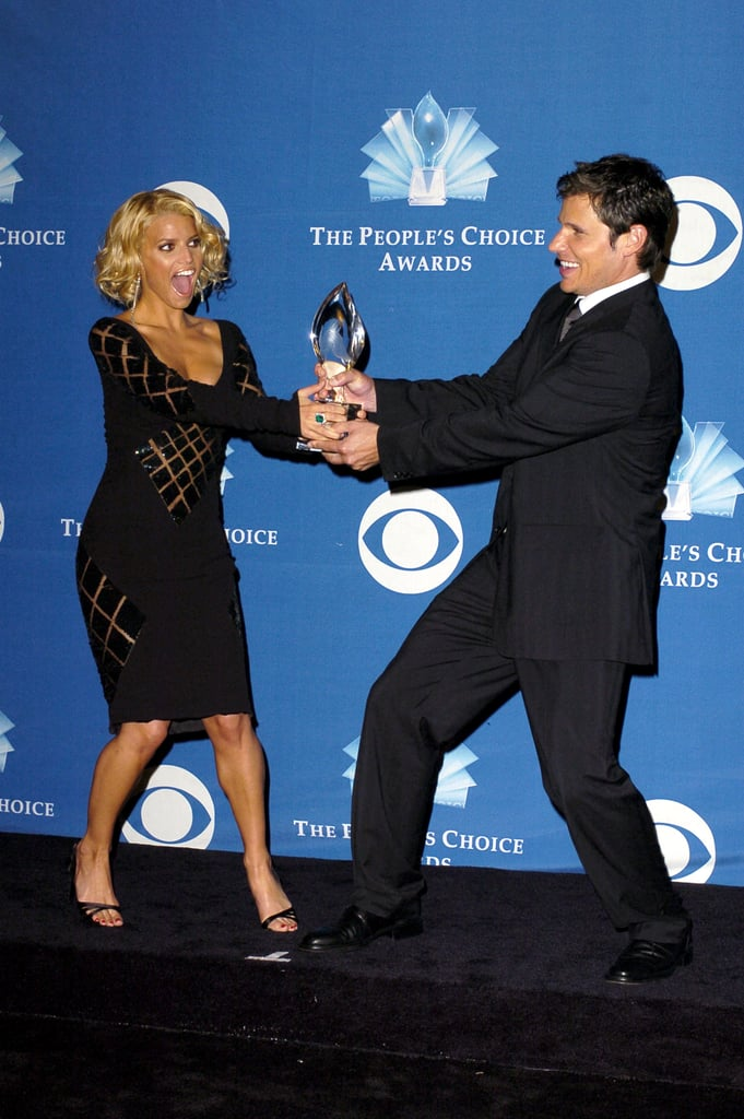 Jessica Simpson and Nick Lachey staged a faux fight while posing with their award in 2005.