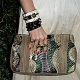 Louise Roe showed off the Spring snake-print trend with this statement clutch in tow.