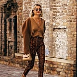 Invest in a trendy cardigan made for showing off. This mixed-fabric option is the star of the show, so tucking it into a classic print like leopard allows it to stand out.