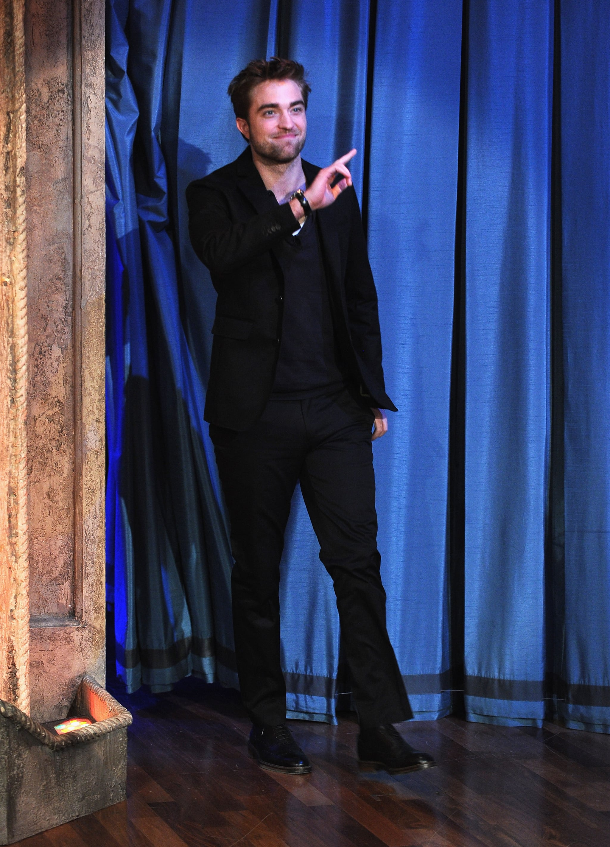 Rob stepped onto the stage and waved to the crowd.