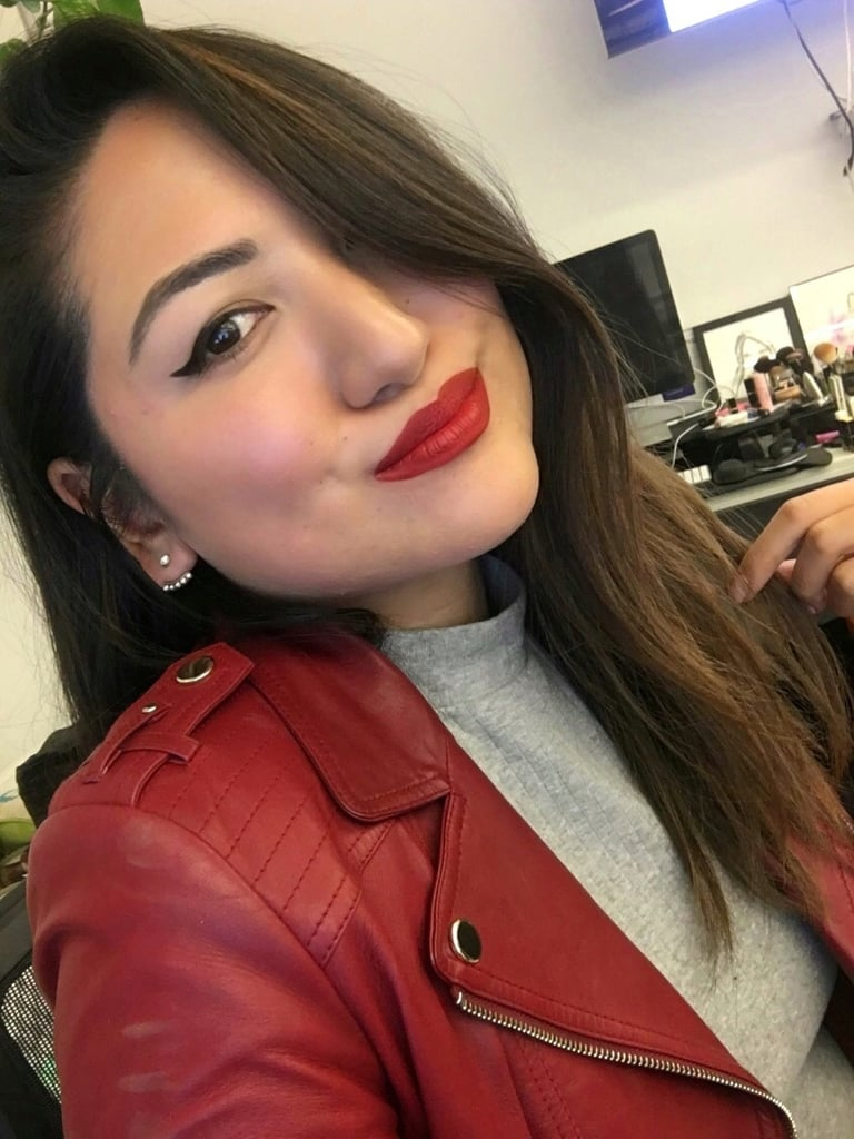 """Red is my colour. So when I saw Fenty Beauty was coming out with a liquid lipstick, I couldn't wait to get my hands on it. Colour-wise, it did not disappoint. The blue-red tint is perfect for my medium-tan skin tone. And the pigment? Goodness is it powerful — I did my entire lip with just one dip of the applicator! My only con is that it feels a bit drying on the lips, but that can easily be remedied by prepping with a balm first. You also have to be super careful with applying because the formula does not budge (so, don't apply it in the back of a taxi!). I got a ton of compliments from friends on the shade, so I'm going to say Rihanna wins yet again."" — Kristina"