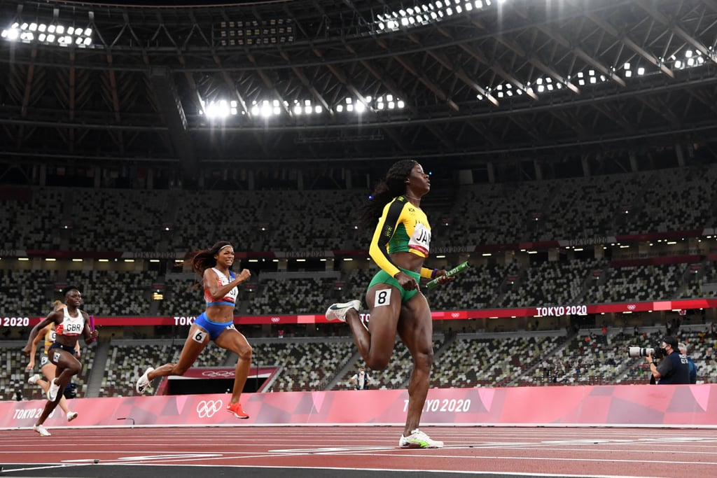 The US women's track team notched yet another medal in Tokyo on Friday night, grabbing silver in the women's 4x100m relay while Jamaica raced to the second fastest time ever to claim gold. Great Britain won bronze. Anchoring the US team was 200m bronze medalist Gabby Thomas, bronze medalist in the 200m alongside Javianne Oliver, Teahna Daniels, and Jenna Prandini. Jamaica fielded a star-studded team that was always going to be tough to catch, as it included the three 100m medalists — Elaine Thompson-Herah, Shelly-Ann Fraser-Pryce, and Shericka Jackson — as well as Briana Williams on the first leg. Jamaica maintained a comfortable lead from start to finish, with the US making up ground throughout to secure a comfortable silver. Jamaica posted a blistering time of 41.02, just two tenths off the world record. Ahead, see photos of the intense race and all the medalists!      Related:                                                                                                           Longtime Rivals and Friends Found Out They Could Share the Gold Medal, and the Photos Are Pure Joy