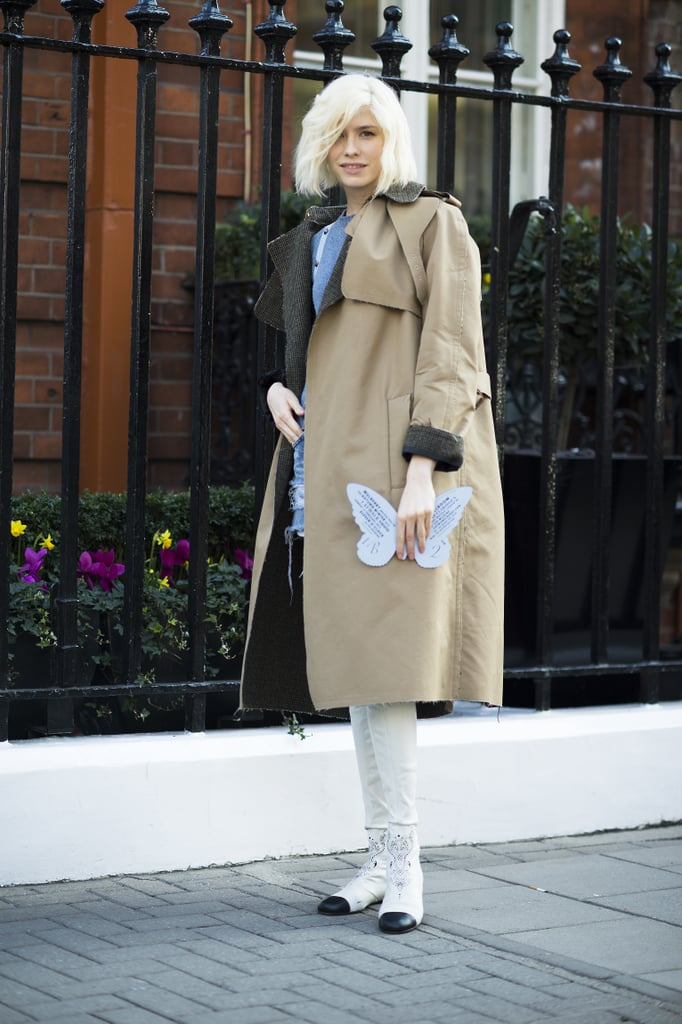 Equal parts edgy and polished with tattered cutoffs and a standout trench — plus some serious statement power via a pair of thigh-high Chanel boots. Source: Le 21ème | Adam Katz Sinding