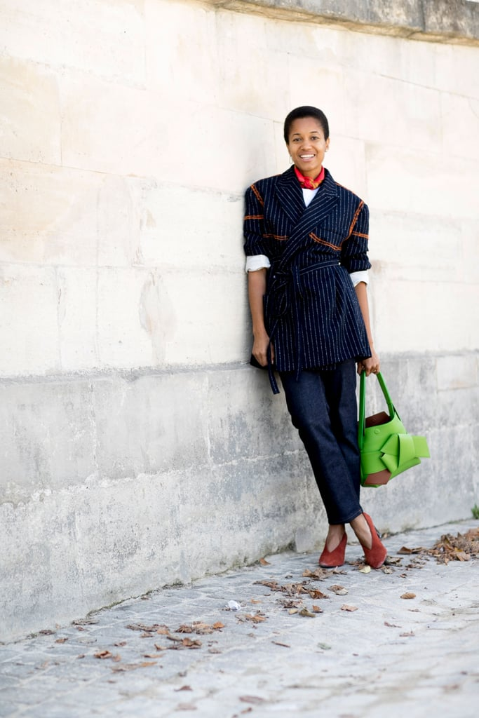 Tamu McPherson found small ways to play with the uniform — add a bandana, belt a blazer, or add interest with a bold bag. Work-appropriate doesn't have to be stuffy.