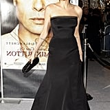 At the premiere of The Curious Case of Benjamin Button in 2008 wearing a classic black strapless gown.