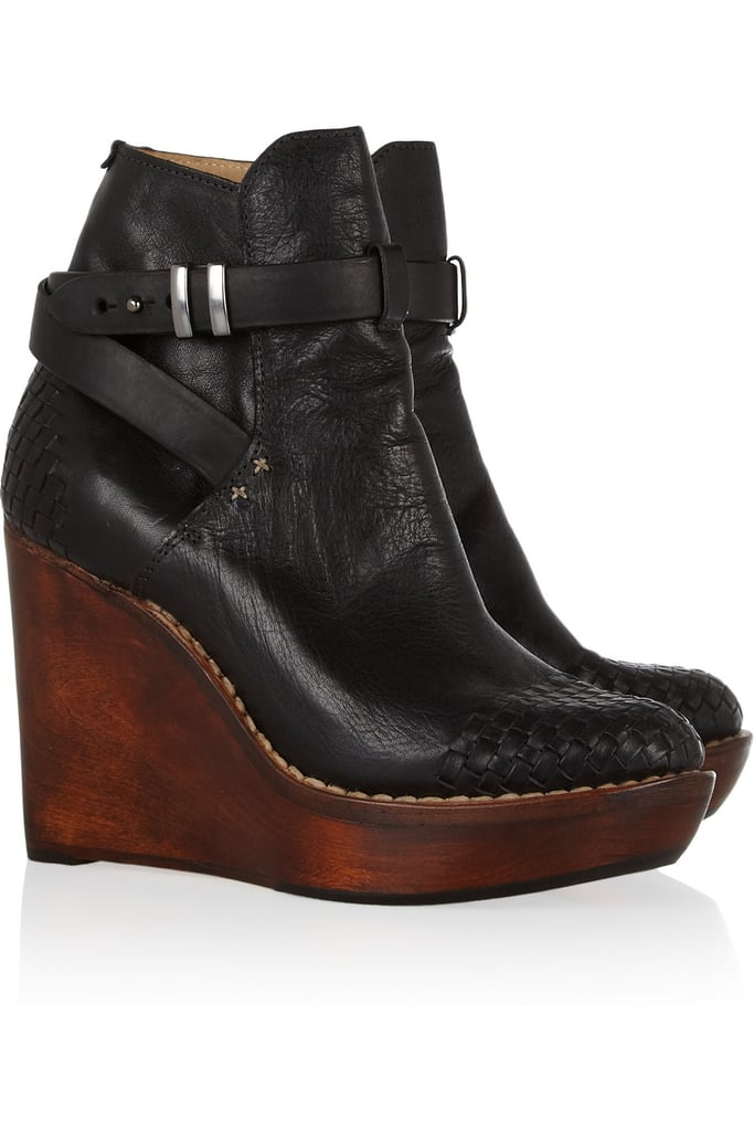 A wedge makes these entirely wearable, but the combo between black leather, strappy buckles, and a wood sole make them covetable.  Rag & Bone Emery Wedge Leather and Wood Ankle Boots ($615)