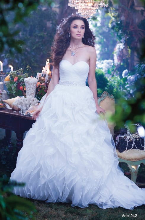 The Alfred Angelo Ariel gown ($1,399) takes its cue from her ocean home with waves of organza.
