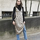 You can't go wrong with a leopard dress — the print looks just right up against denim and a black turtleneck.