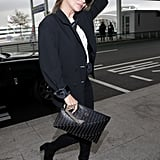 Kate Moss flaunts her inimitable airport style at Incheon International Airport in South Korea.