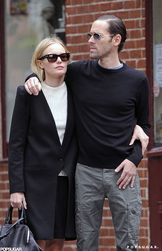 Kate Bosworth held tight to boyfriend Michael Polish while out and about in NYC.