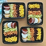 Taco salad with shredded lettuce, chicken, corn, beans, and toppings.