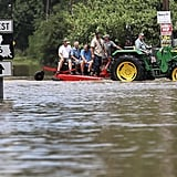 People are rescued by a tractor in Port Vincent, LA.