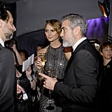 George Clooney and Stacy Keibler toasted with Champagne at the Governors Ball after the Oscars.