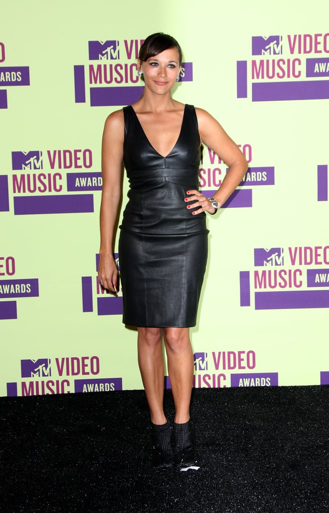 Rashida Jones took the sexy-chic route for the event in a low-cut leather dress and booties.