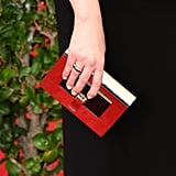 Orange Is the New Black actress Natasha Lyonne tightened up her look by matching her simple Fred Leighton rings to her metallic box clutch perfectly.