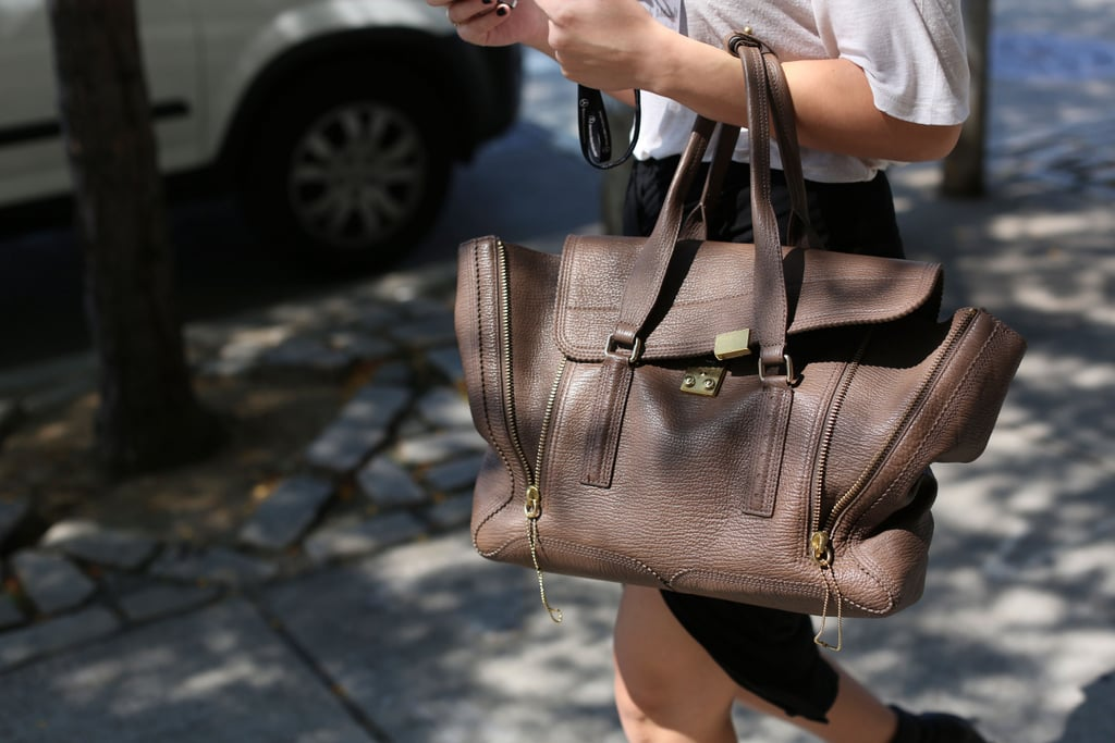 A neutral-hued Phillip Lim Pashli was the ever-sophisticated finish on the lucky arm of this showgoer.