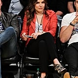 We're smitten with Sophia Bush's courtside ensemble — her jeans and tee combo got a jolt with the help of a coral-colored leather jacket and leopard-print heels. Game on!