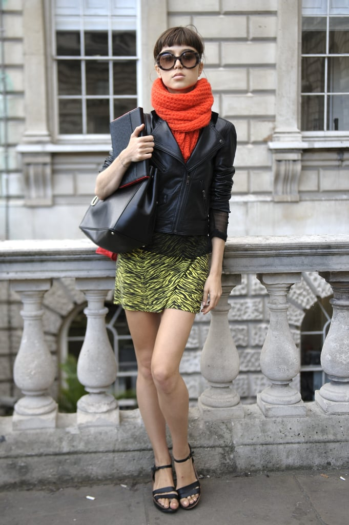 Set off shorter proportions with a bold-hued — and chunky — scarf.