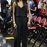 Gabrielle Union opted for a belted black jumpsuit and shoulder bag at a recent Heat game.