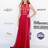 Taylor Swift wowed (and surprised us) in a sexy red Elie Saab number — can we talk about that lace-infused bodice? We love that she rocked a more unexpected dress with her signature approach to minimalistic accessorizing.