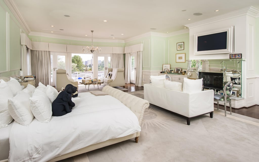 In crisp white and cool pastel green, this bedroom — one of 17 — is relaxing and serene.