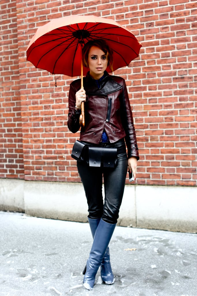 This styler enlisted a parasol and a pair of knee-high boots to battle the blizzard.