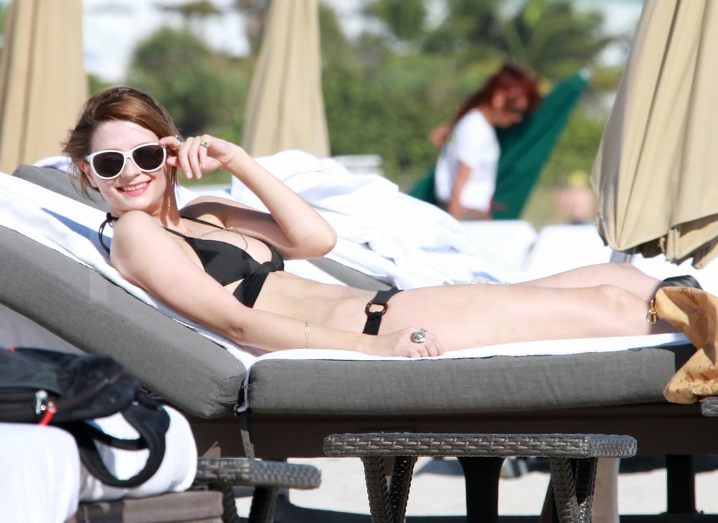 Mischa Barton showed off her hot bikini body in a skimpy black two-piece lounging on the beach in Miami on Tuesday. The actress looked to be in good spirits as she chatted with a friend and worked on her tan. Mischa is currently focusing on her fashion career more so than acting, but whatever she's doing looks to be agreeing with her. She does have a couple movie projects in the works as well, so perhaps we'll be seeing more of Mischa in the coming year. For now though, joining the throngs of celebrities in bikinis, from Sofia Vergara to Katy Perry, seems like a great way to close out 2011.