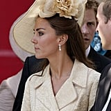 A floral-adorned headpiece topped her look at Zara Phillips and Mike Tindall's wedding in 2011.