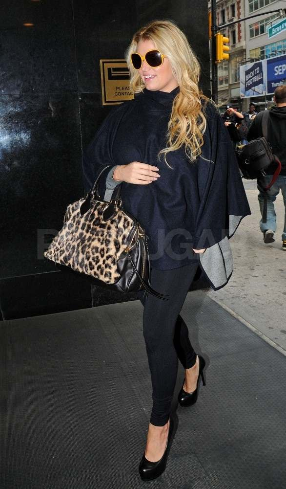 Jessica Simpson in a black cape in NYC.
