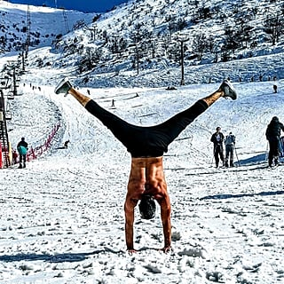 Shirtless Men Doing Yoga in the Snow