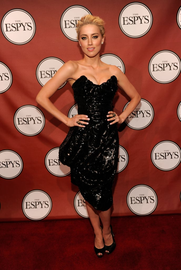Amber put her defined décolletage on display in a black embellished bustier-style dress at the 2011 ESPY Awards in LA.