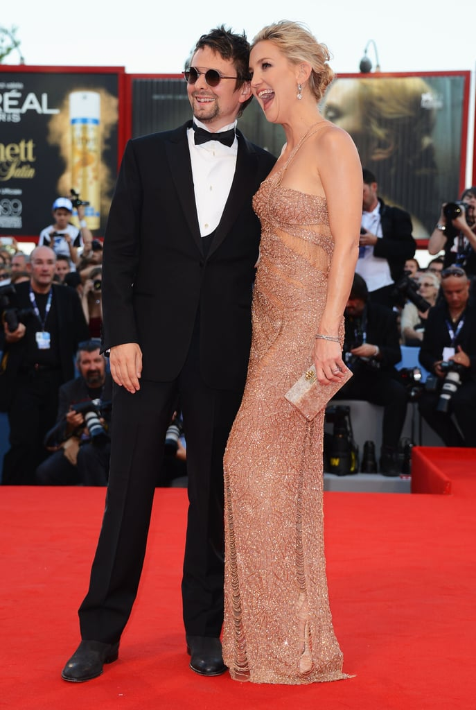 Kate Hudson and fiancé Matthew Bellamy made a glamorous red carpet appearance at the Venice Film Festival yesterday. Kate looked stunning in an Atelier Versace gown while Matthew chose a classic tuxedo for the event. Kate showed off her famous grin and gave Matthew lots of love on their way into the screening. The duo is in Italy to promote Kate's The Reluctant Fundamentalist, and her co-star Liev Schreiber was on hand as well. Liev showed up at the film's premiere with Naomi Watts, who was in a nude Marchesa look.