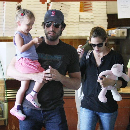 Ben Affleck in a Red Sox Hat Carrying Seraphina Pictures