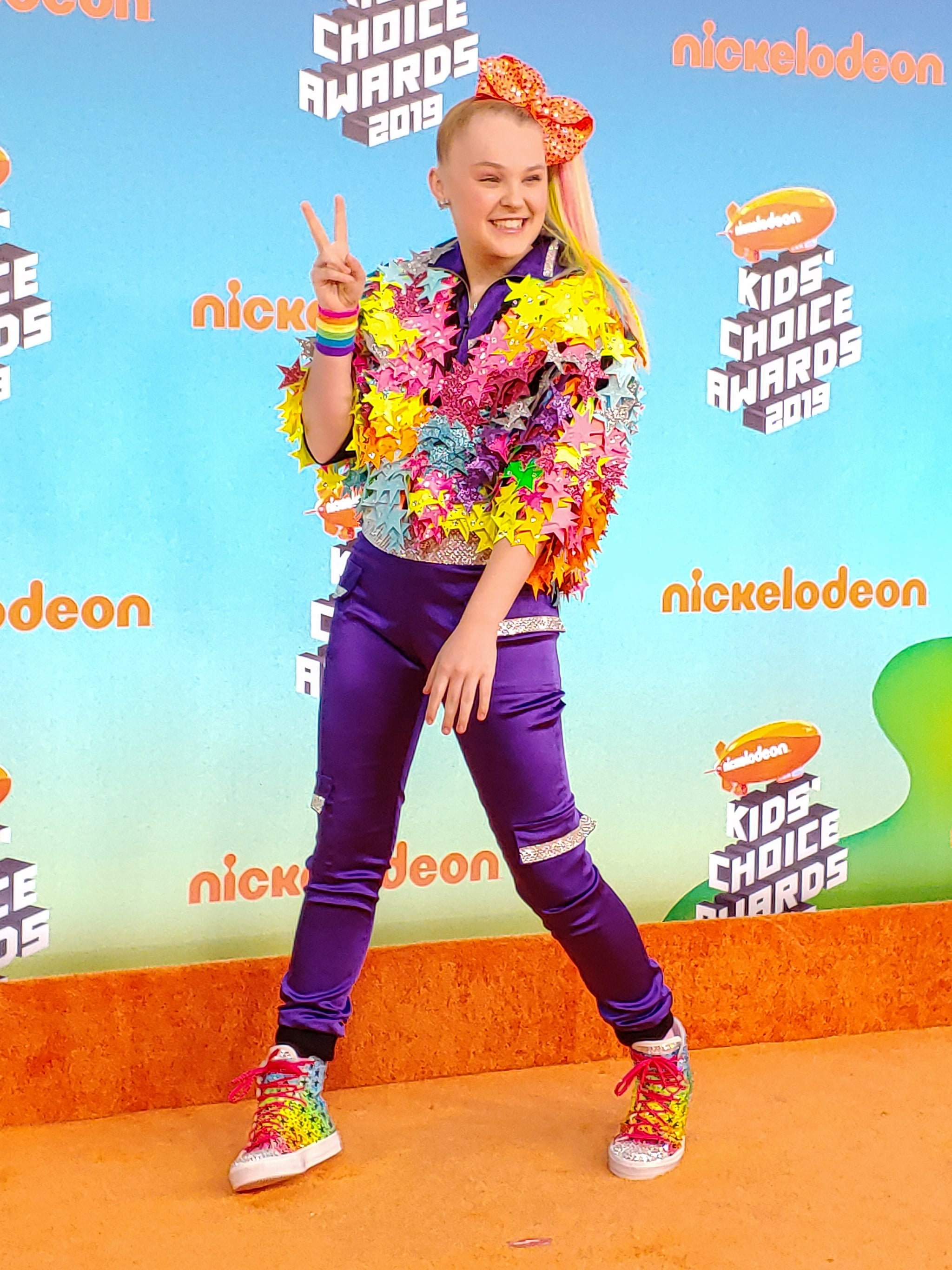 LOS ANGELES, CALIFORNIA - MARCH 23: (Image was captured on the LG V40 ThinQ) JoJo Siwa attends Nickelodeon's 2019 Kids' Choice Awards  at Galen Centre on March 23, 2019 in Los Angeles, California. (Photo by Presley Ann/FilmMagic)