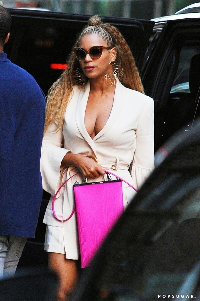 So, Beyoncé wore a plunging V-neck blazer while out in NYC with JAY-Z, but that's not even what got our attention. Queen Bey accessorised her look with a handful of standout pieces, but none more eye-catching than her handbag.  She rocked a cream blazer with matching shorts, Slinky-style earrings, oversize brown sunglasses, and a neon pink Off-White handbag that is definitely long enough to fit a full-size bottle of hot sauce, and maybe even her gorgeous Vogue issue. The $490 one-of-a-kind tote bag is statement worthy because of its rectangular shape, metallic handle, and bright colour. Keep scrolling to get your hands on Beyoncé's exact handbag and similar options.