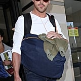 Ryan Gosling wore headphones as he arrived at LAX.