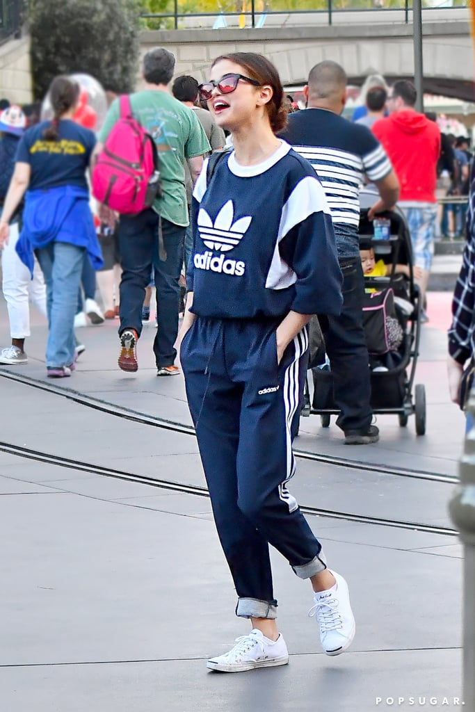 "When Selena Gomez took her family to Disneyland, she was casually dressed down in a navy Adidas pullover and matching sweats. The athleisure ensemble was cute and cozy, but it didn't exactly scream ""I'm at Disneyland!"" That is, until we saw a glimpse of the grooviest Alice in Wonderland bag. The '70s-style graphics, printed on the front of her shoulder bag, referenced several characters and important items (the potion bottle!) from the animated film, and it was this accessory that completely changed the direction of Selena's theme-park look. She may not have worn Mickey Mouse ears like some other celebs who have gone to Disneyland, but the whimsical bag proved she's truly a Disney girl at heart. Not a bad choice as a carryall to one of the happiest places on Earth. Selena then topped off her comfy look with her trusted Converse x Jack Purcell low tops. Scroll on to have a closer look at the Alice in Wonderland piece yourself.      Related:                                                                                                           Selena Gomez Isn't the First to Give Travel Sweatpants a High-Fashion Makeover"