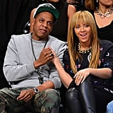Beyoncé and Jay Z took in a Brooklyn Nets game in NYC in November 2012 and cutely celebrated when the team scored.