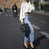 Alessandra Ambrosio Wore Re/Done Jeans With an Orseund Iris Top in Paris