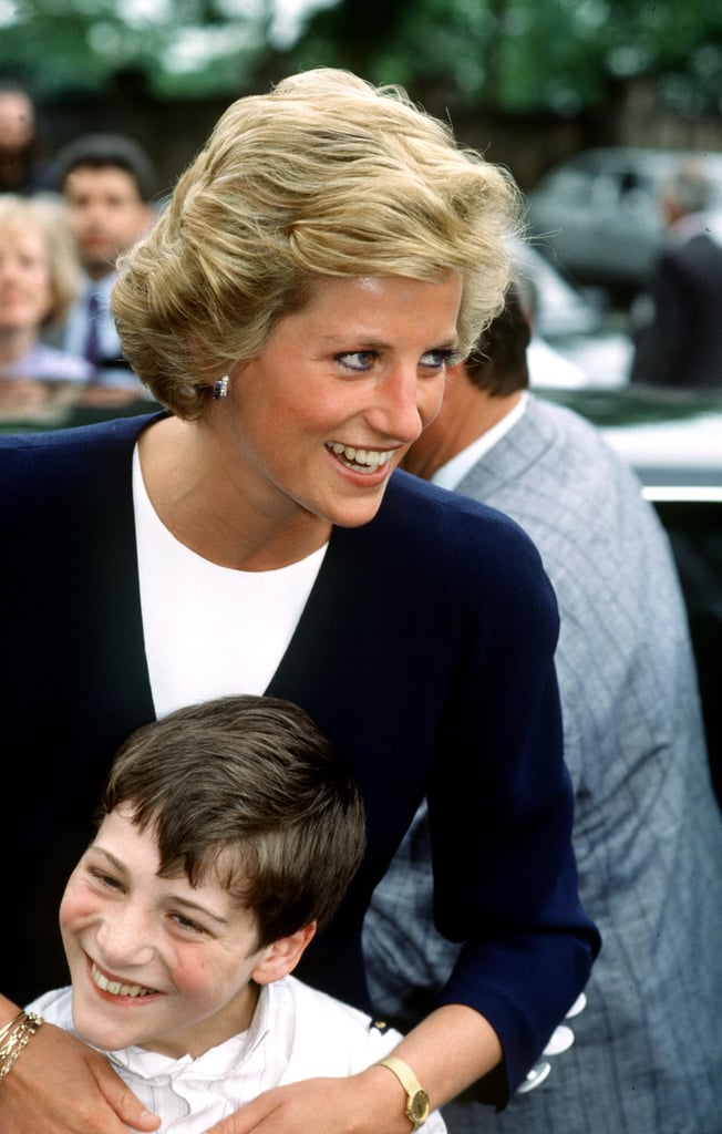 In May 1990, Princess Diana wrapped a young boy in her arms while visiting the Peto Institute in Budapest, Hungary.