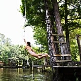 Rope-swing into a lake.
