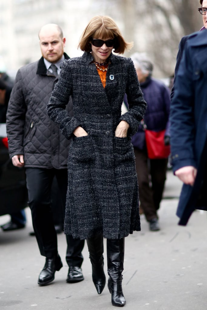 We'll never tire of Anna Wintour's brand of polish — spotted in a tweed coat, knee-high boots, and a printed sheath.