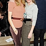 Rosie Huntington-Whiteley and Kate Bosworth strike a pose while attending the Burberry Fall 2012 fashion show.