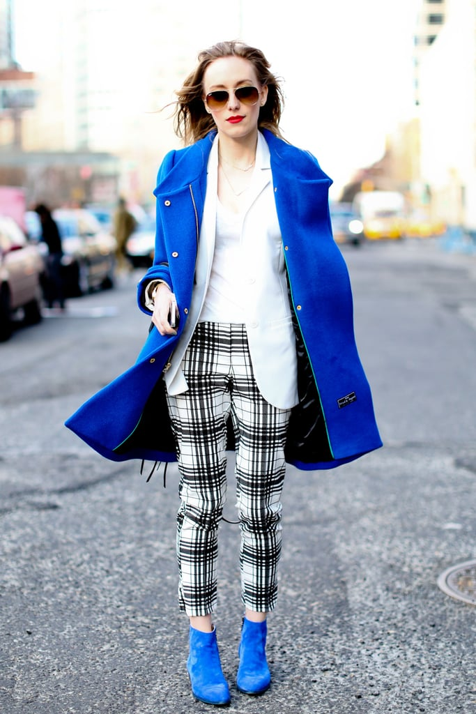 This show-goer echoed the same pop of royal blue on her coat and shoes for a rich color palette.