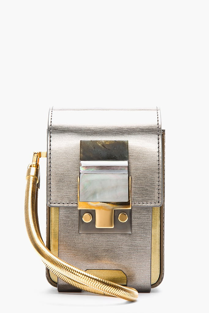 If your camera's always at your side, then it deserves a statement bag of its own. Lanvin's metallic silver and gold case ($2,280) fits the bill nicely.