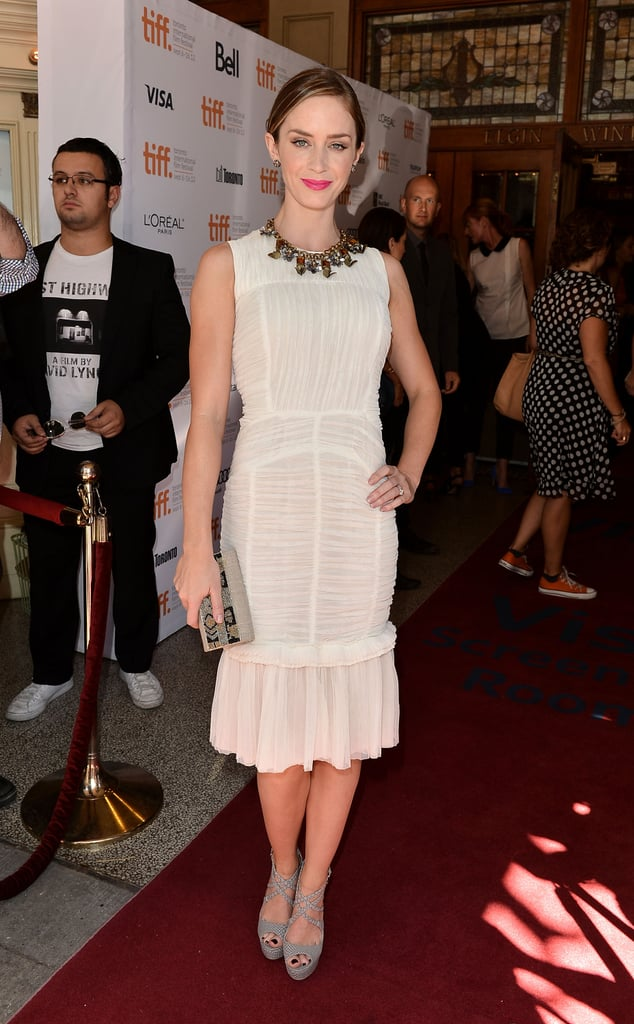 Emily Blunt showed off her figure in a fitted white dress.