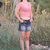 Natalie Portman wore a denim miniskirt and pink shirt on set in Texas.